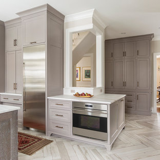 Design ideas for a large l-shaped eat-in kitchen in Minneapolis with an undermount sink, recessed-panel cabinets, grey cabinets, marble benchtops, coloured appliances, porcelain floors and with island.