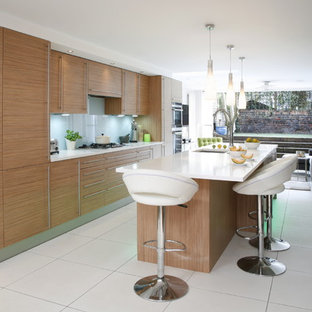 Photo of a contemporary kitchen in London with flat-panel cabinets and light wood cabinets.