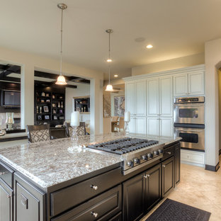 Inspiration for a mid-sized traditional galley eat-in kitchen in Seattle with an undermount sink, granite benchtops, stainless steel appliances, marble floors, with island, louvered cabinets, light wood cabinets and black splashback.