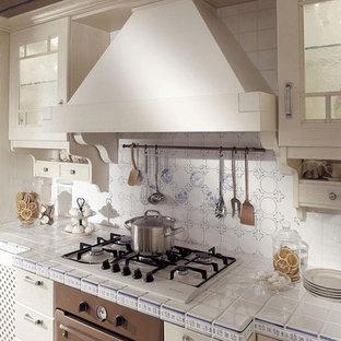 Kitchen - mediterranean kitchen idea in Miami