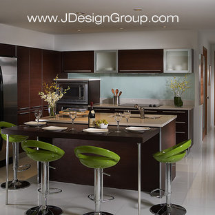 Design ideas for a mid-sized contemporary l-shaped eat-in kitchen in Miami with an undermount sink, flat-panel cabinets, dark wood cabinets, marble benchtops, white splashback, glass sheet splashback, stainless steel appliances, marble floors, with island and white floor.