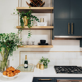 Modern eat-in kitchen designs - Minimalist l-shaped medium tone wood floor eat-in kitchen photo in San Francisco with an undermount sink, flat-panel cabinets, gray cabinets, quartz countertops, white backsplash, marble backsplash, stainless steel appliances and white countertops