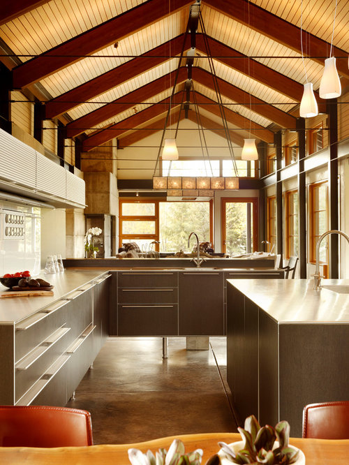 trendy open concept kitchen photo in los angeles with flat panel cabinets brown cabinets. Interior Design Ideas. Home Design Ideas