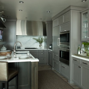 Inspiration for a contemporary kitchen remodel in Chicago with shaker cabinets, gray cabinets, paneled appliances, white backsplash and stone slab backsplash