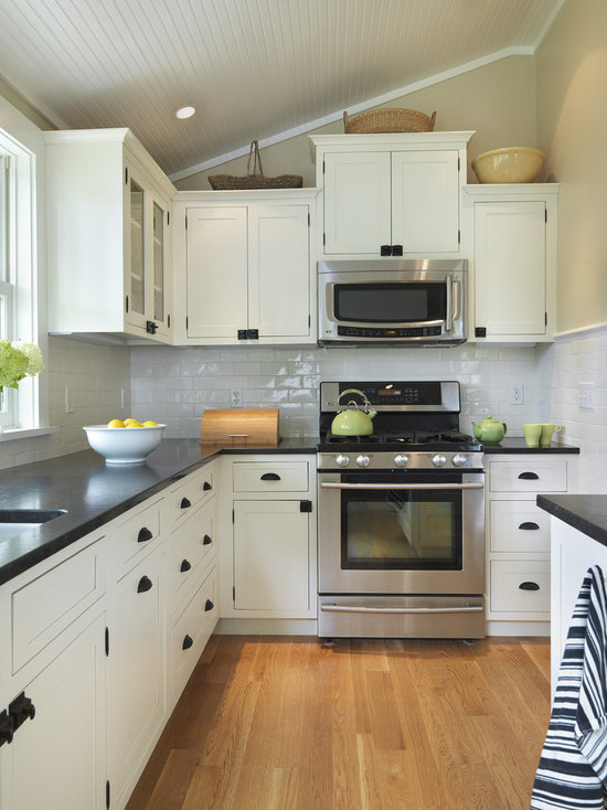 white cabinets with black countertops | houzz