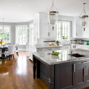 Example of a classic eat-in kitchen design in Toronto with quartz countertops