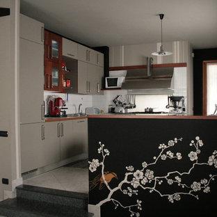 ミラノのアジアンスタイルのおしゃれなキッチンの写真