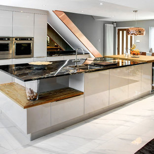 Inspiration for a medium sized contemporary kitchen/diner in Other with flat-panel cabinets, an island, white floors, white cabinets, granite worktops, metallic splashback, mirror splashback, stainless steel appliances and porcelain flooring.