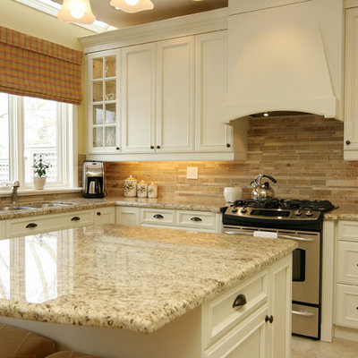 Inspiration for a mid-sized timeless u-shaped ceramic tile kitchen remodel in Toronto with granite countertops, a double-bowl sink, recessed-panel cabinets, white cabinets, brown backsplash, stainless steel appliances, stone tile backsplash and an island