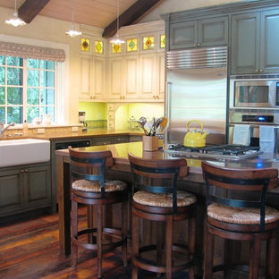 Large traditional l-shaped open plan kitchen in Seattle with an undermount sink, green cabinets, stainless steel appliances, dark hardwood floors, with island, zinc benchtops and brown floor.