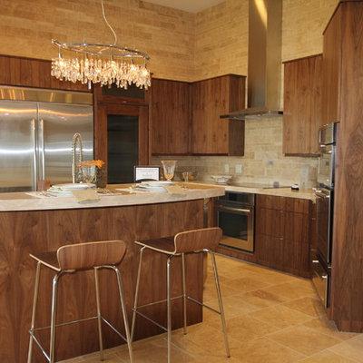 Example of a trendy kitchen design in Cedar Rapids with stainless steel appliances, flat-panel cabinets, medium tone wood cabinets, beige backsplash and travertine backsplash