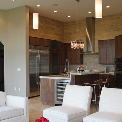 Example of a trendy l-shaped open concept kitchen design in Cedar Rapids with stainless steel appliances, flat-panel cabinets, dark wood cabinets, beige backsplash and stone tile backsplash