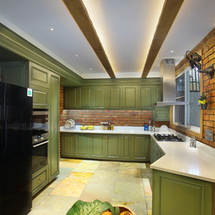 Mid-sized contemporary enclosed kitchen inspiration - Mid-sized trendy multicolored floor enclosed kitchen photo in Delhi with raised-panel cabinets, green cabinets, red backsplash, brick backsplash, stainless steel appliances and beige countertops