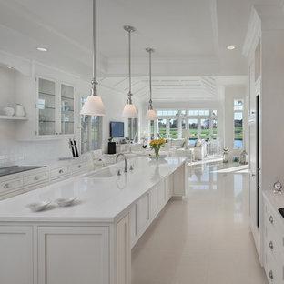 Tropical kitchen photos - Island style kitchen photo in Miami