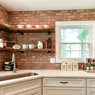 Mid-sized farmhouse enclosed kitchen ideas - Mid-sized country u-shaped dark wood floor and brown floor enclosed kitchen photo in DC Metro with an undermount sink, white cabinets, stainless steel appliances, shaker cabinets, wood countertops, red backsplash, brick backsplash and a peninsula
