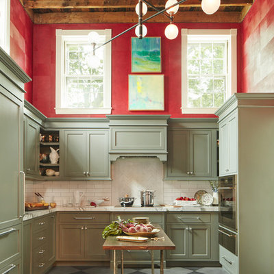 Inspiration for a mid-sized transitional u-shaped porcelain tile and gray floor kitchen remodel in Boston with marble countertops, white backsplash, paneled appliances, an island, shaker cabinets, green cabinets and subway tile backsplash