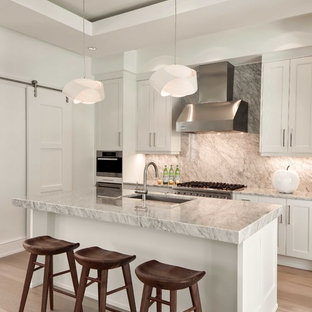 Tropical kitchen inspiration - Kitchen - tropical kitchen idea in Miami with an island
