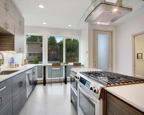 Inspiration for a contemporary galley eat-in kitchen remodel in Other ...