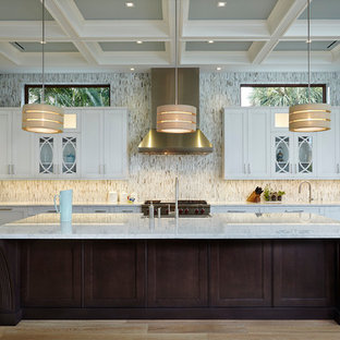 Inspiration for a large transitional l-shaped separate kitchen in Miami with shaker cabinets, white cabinets, multi-coloured splashback, stainless steel appliances, light hardwood floors, with island, an undermount sink, marble benchtops, matchstick tile splashback and brown floor.
