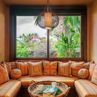Ispirazione per una grande cucina tropicale con lavello a vasca singola, top in granito, elettrodomestici in acciaio inossidabile e pavimento in travertino