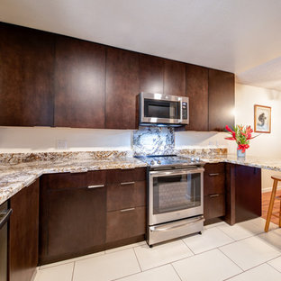 Photo of a small modern u-shaped separate kitchen in Hawaii with a single-bowl sink, flat-panel cabinets, dark wood cabinets, granite benchtops, stainless steel appliances, ceramic floors, no island, beige floor and yellow benchtop.