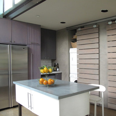 Example of a large trendy l-shaped light wood floor eat-in kitchen design in San Francisco with stainless steel appliances, an undermount sink, flat-panel cabinets, white backsplash, subway tile backsplash, an island, purple cabinets and marble countertops