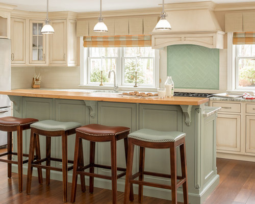 traditional kitchen ideas elegant medium tone wood floor kitchen photo in portland maine with an - Beaded Inset Kitchen Decor
