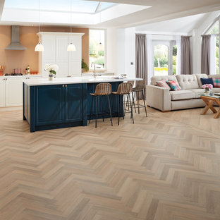 Large contemporary kitchen in Manchester with vinyl flooring and multi-coloured floors.