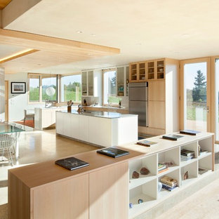 Example of a trendy eat-in kitchen design in Portland with flat-panel cabinets and light wood cabinets