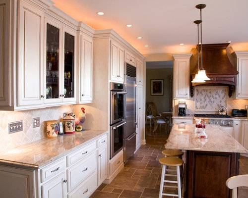 Large Elegant L Shaped Travertine Floor Eat In Kitchen Photo In  Philadelphia With An. Save Photo. Stoneshop · 42 Reviews · Kashmir Gold  Granite Kitchen