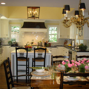 Traditional eat-in kitchen photos - Eat-in kitchen - traditional u-shaped eat-in kitchen idea in San Francisco with raised-panel cabinets, white cabinets and white backsplash