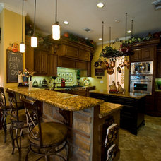 Traditional Kitchen by Glamm Interiors