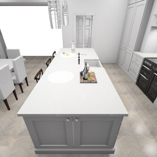 Photo of a mid-sized traditional galley eat-in kitchen in Other with an integrated sink, shaker cabinets, grey cabinets, quartzite benchtops, metallic splashback, mirror splashback, panelled appliances, medium hardwood floors, with island, grey floor and white benchtop.