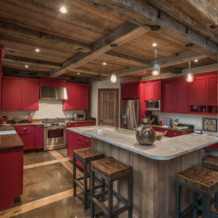 Rustic kitchen designs - Example of a mountain style u-shaped kitchen design in Charleston with a farmhouse sink, shaker cabinets, red cabinets, stainless steel appliances and concrete countertops
