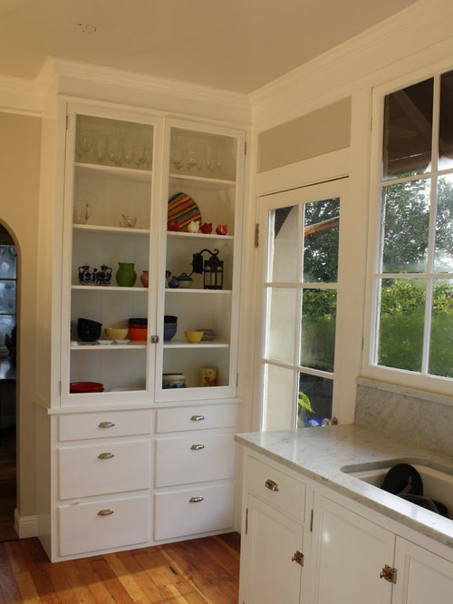 Traditional Kitchen Remodeling   Example Of A Classic Kitchen Design In San  Francisco With Glass