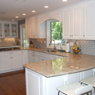 Contemporary eat-in kitchen ideas - Example of a trendy u-shaped medium tone wood floor eat-in kitchen design in New York with raised-panel cabinets, white cabinets, quartzite countertops, gray backsplash, subway tile backsplash, stainless steel appliances, a single-bowl sink and a peninsula