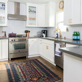 Eclectic kitchen remodeling - Inspiration for an eclectic l-shaped medium tone wood floor and brown floor kitchen remodel in Los Angeles with an undermount sink, shaker cabinets, white cabinets, white backsplash, stainless steel appliances and no island