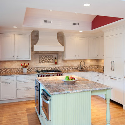 Mid-sized elegant u-shaped light wood floor and beige floor enclosed kitchen photo in DC Metro with shaker cabinets, a double-bowl sink, white cabinets, granite countertops, beige backsplash, porcelain backsplash, stainless steel appliances and an island