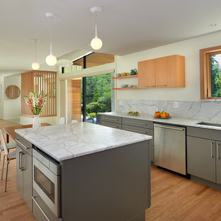 This is an example of a mid-sized midcentury l-shaped eat-in kitchen in DC Metro with an undermount sink, flat-panel cabinets, grey cabinets, marble benchtops, white splashback, stone slab splashback, stainless steel appliances, light hardwood floors, with island and beige floor.