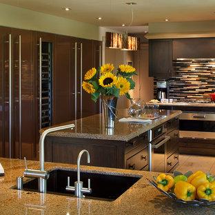 サンフランシスコのアジアンスタイルのおしゃれなキッチン (シングルシンク、フラットパネル扉のキャビネット、濃色木目調キャビネット、御影石カウンター、マルチカラーのキッチンパネル、ボーダータイルのキッチンパネル、シルバーの調理設備の、磁器タイルの床、ベージュの床) の写真