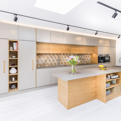 Kitchen - large contemporary single-wall gray floor kitchen idea in London with flat-panel cabinets, gray cabinets, multicolored backsplash, stainless steel appliances, an island, gray countertops and ceramic backsplash