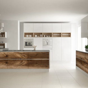 Photo of a medium sized modern single-wall kitchen/diner in Las Vegas with flat-panel cabinets, white cabinets, laminate countertops, white splashback, plywood flooring, an island, beige floors and white worktops.