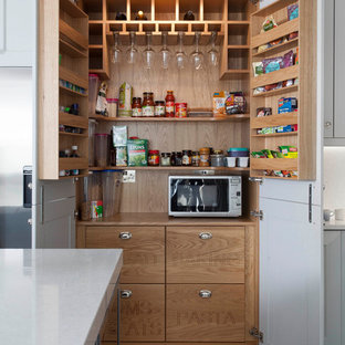 Kitchen pantry - large traditional porcelain floor and brown floor kitchen pantry idea in Other with shaker cabinets, gray cabinets, quartzite countertops, gray backsplash, stone slab backsplash, stainless steel appliances and an island