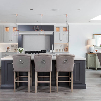 Inspiration for a large timeless l-shaped porcelain tile and brown floor open concept kitchen remodel in Other with an undermount sink, shaker cabinets, gray cabinets, quartzite countertops, gray backsplash, stone slab backsplash, stainless steel appliances and an island