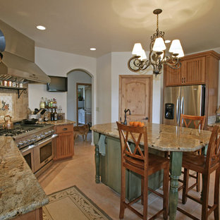 Inspiration for a country kitchen in San Luis Obispo with glass-front cabinets, stainless steel appliances, light wood cabinets, multi-coloured splashback, stone tile splashback and granite benchtops.