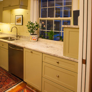 Photo of a large classic l-shaped enclosed kitchen in Boston with a double-bowl sink, shaker cabinets, beige cabinets, granite worktops, stainless steel appliances, medium hardwood flooring, a breakfast bar, brown floors and white worktops.
