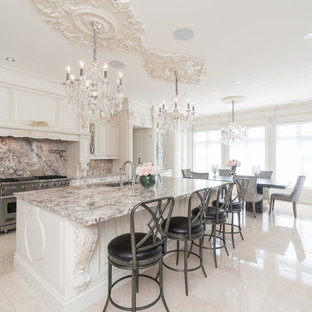 Photo of a large transitional l-shaped eat-in kitchen in Toronto with a double-bowl sink, raised-panel cabinets, beige cabinets, granite benchtops, multi-coloured splashback, marble splashback, stainless steel appliances, marble floors, with island and blue floor.