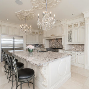 This is an example of a large transitional l-shaped eat-in kitchen in Toronto with a double-bowl sink, raised-panel cabinets, beige cabinets, granite benchtops, multi-coloured splashback, marble splashback, stainless steel appliances, marble floors, with island and blue floor.