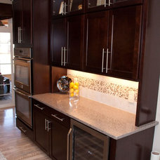 Transitional Kitchen by Classic Custom Homes of Waunakee