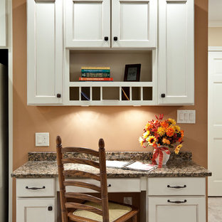 Mid-sized traditional single-wall eat-in kitchen in Atlanta with recessed-panel cabinets, white cabinets, granite benchtops, porcelain floors, beige floor and brown benchtop.